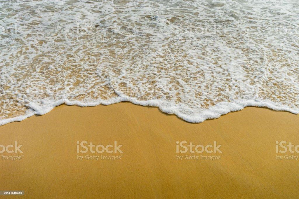 wave of sea on sandy beach royalty-free stock photo