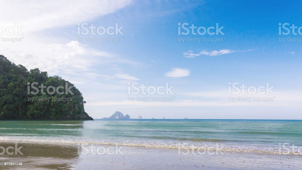Wave of the sea on the sand beach, Beach and tropical sea, Paradise idyllic beach Krabi, Thailand, Summer holidays, Ocean in the evening as nature travel background. stock photo