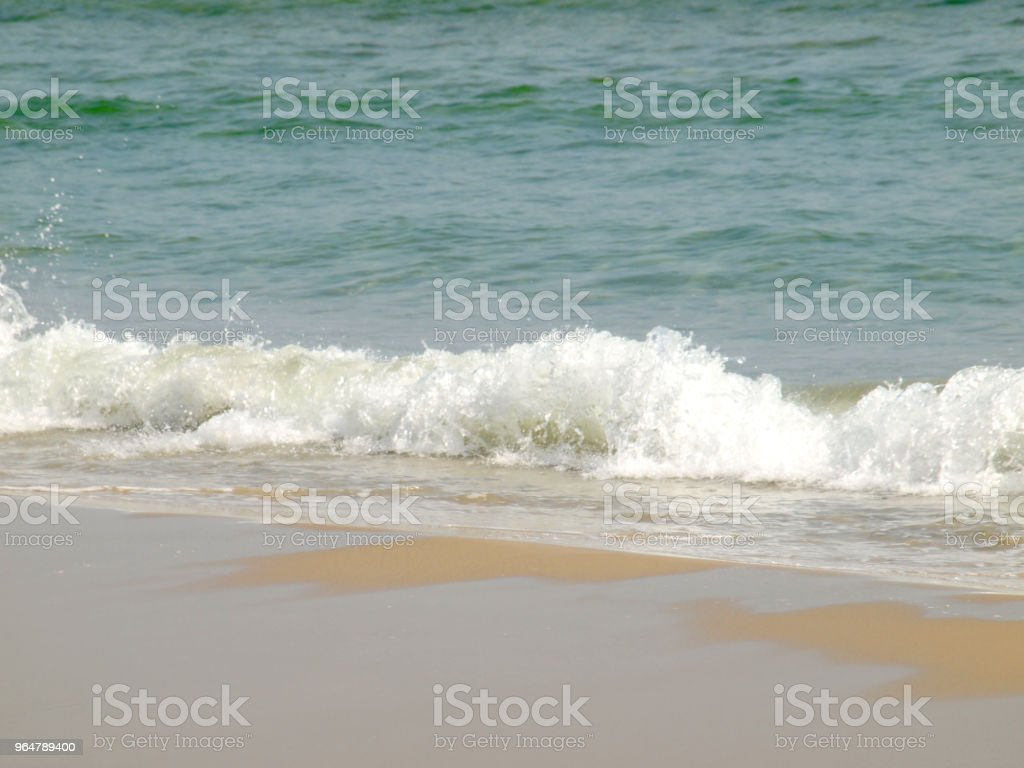 Wave of the sea on the sand beach royalty-free stock photo