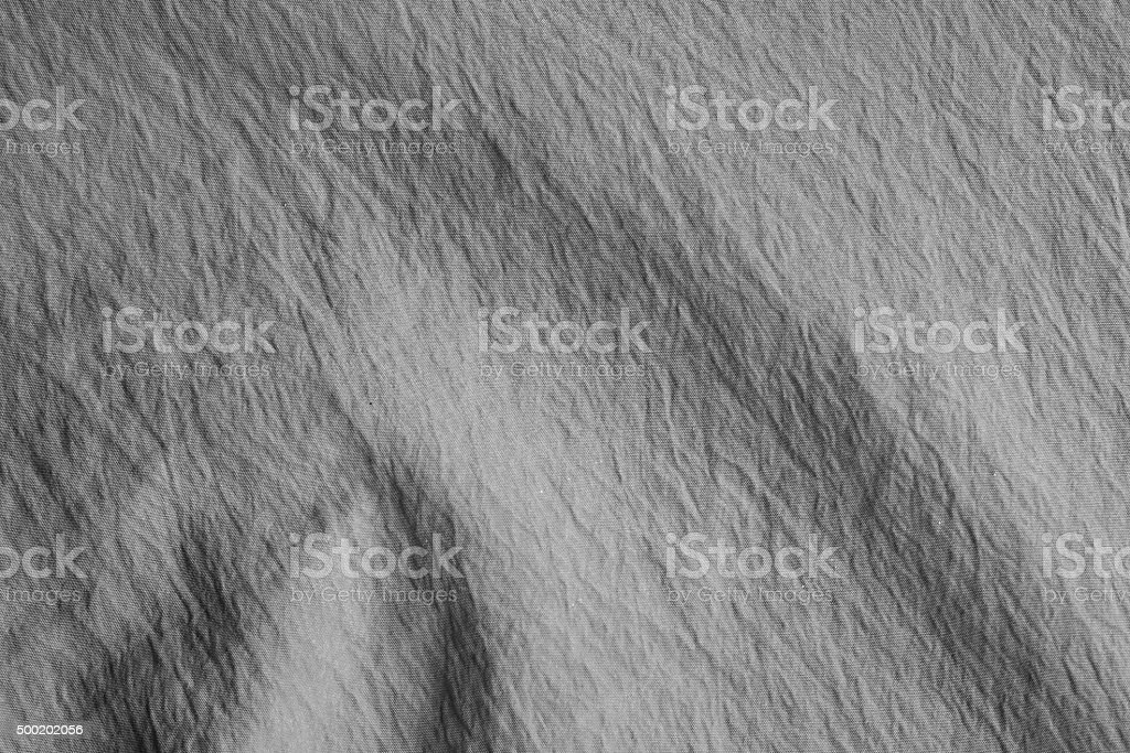 Wave on gray crumpled fabric background. stock photo