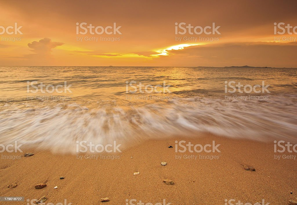 Wave on the beach and sunset sky royalty-free stock photo