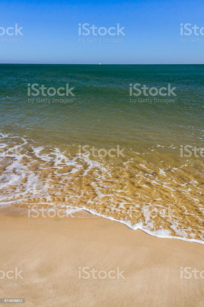 Wave on the beach stock photo
