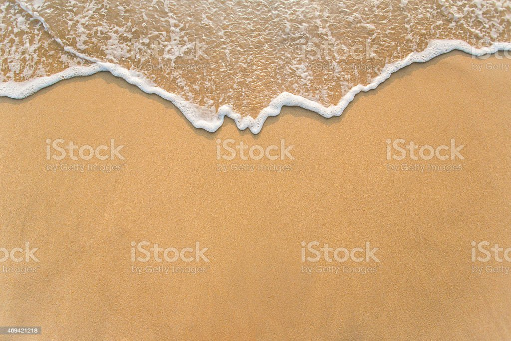 Wave on the sand beach background stock photo
