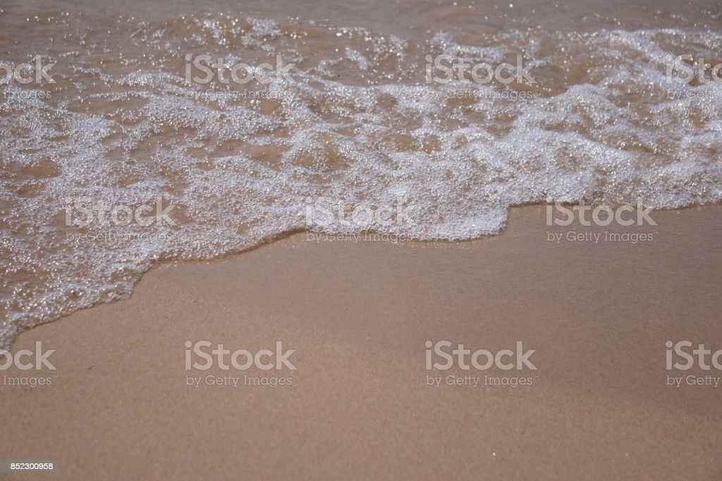 Wave on the sand beach stock photo