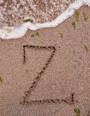 Wave Over Letter Z On The Beach Stock Photo - Download Image