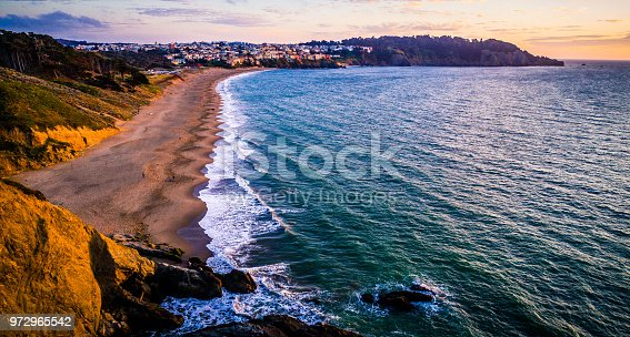 Aerial drone view above Wave pattern along California coastline during amazing sunset on Bakers Beach near San Francisco along California pacific coast highway travel destination first stop