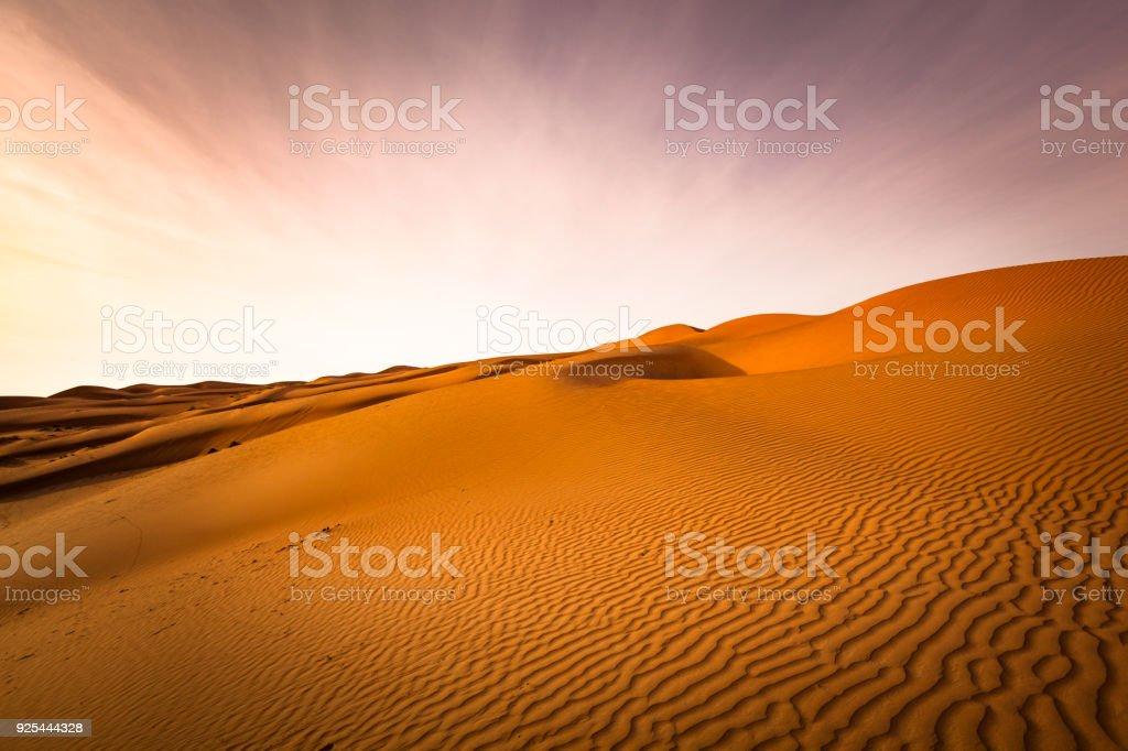 wave pattern desert landscape at sunset, oman