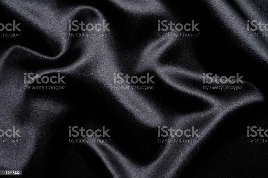 Wave pattern of black satin texture background stock photo