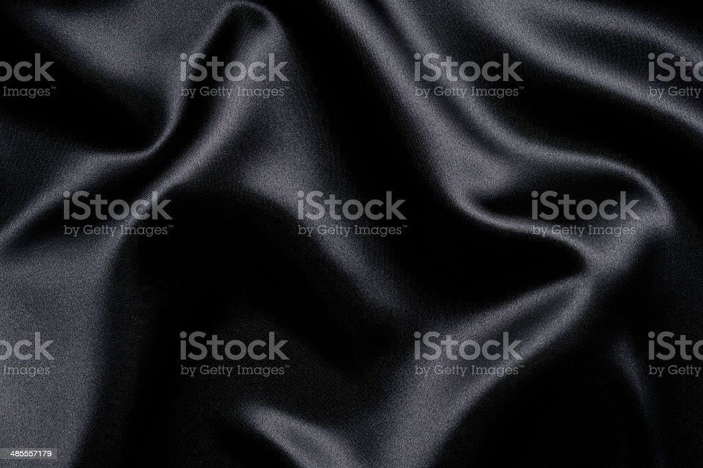 Wave pattern of black satin texture background stock photo