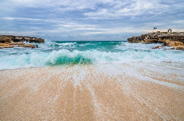 Wave rushing back to ocean, El Mirador, Cozumel, Mexico stock photo