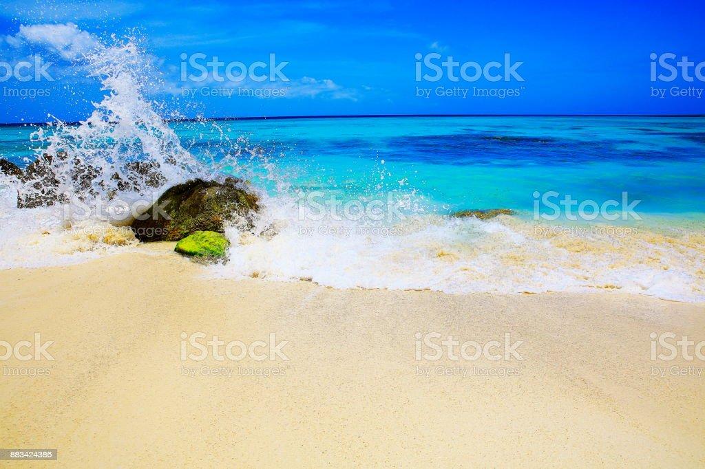 Wave splash against rock - Idyllic Arashi tropical turquoise Beach, Aruba – sunny blue lagoon, summer paradise, Dutch Antilles, Caribbean Blue sea stock photo