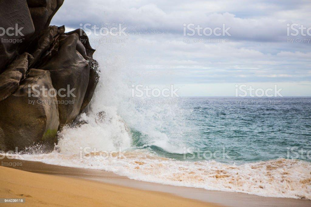 Wave Splashing Against Rocks in Cabo San Lucas royalty-free stock photo