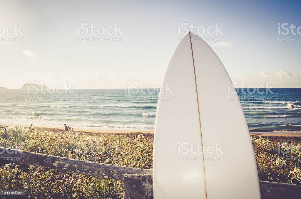 Wave Surfboard on the Beach stock photo