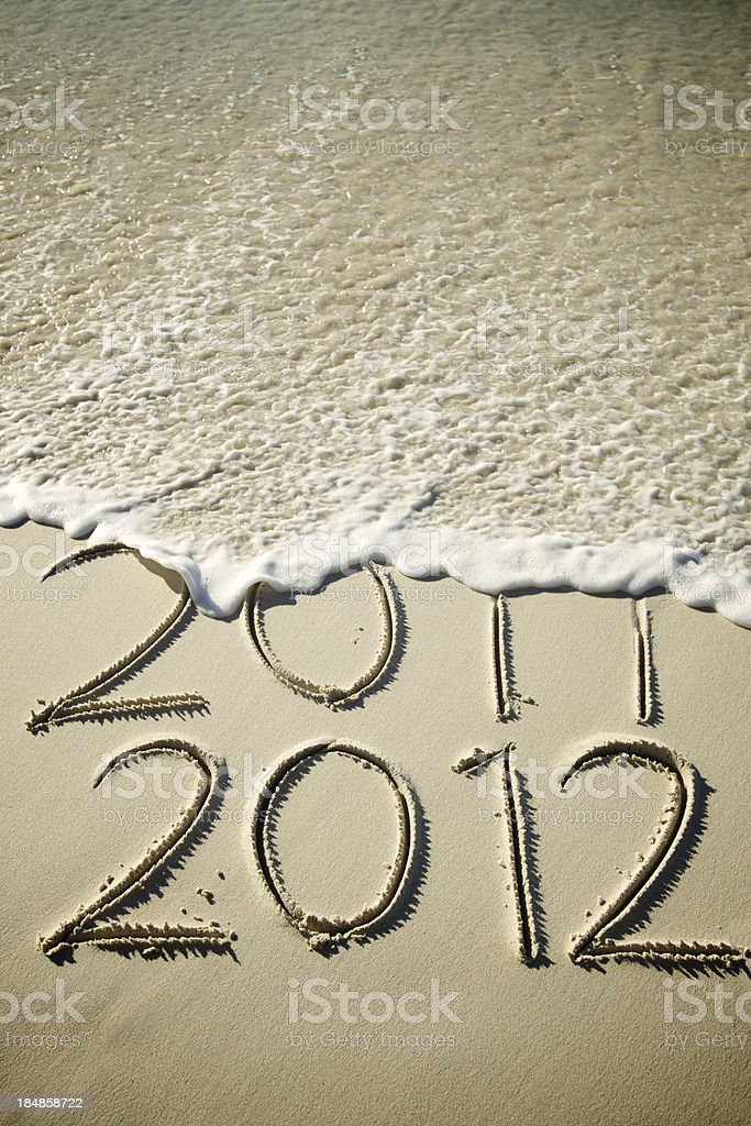 Wave Washes 2011 Away Leaving 2012 stock photo