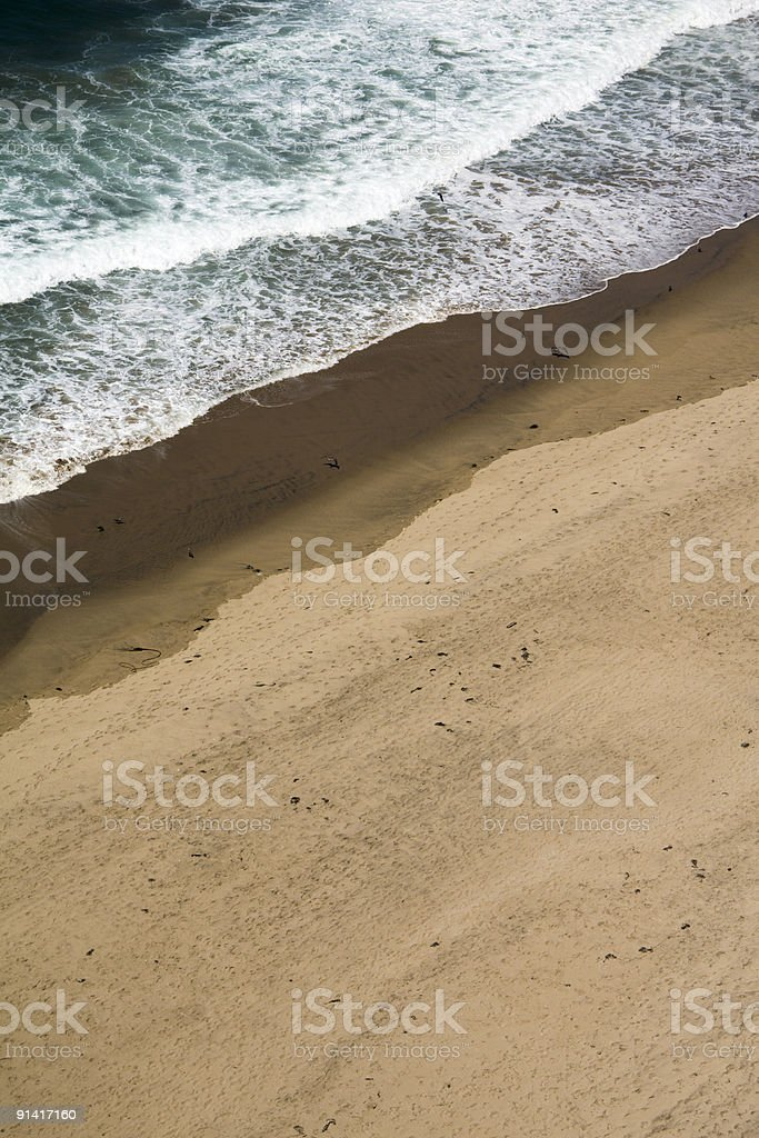Waves Against Beach royalty-free stock photo