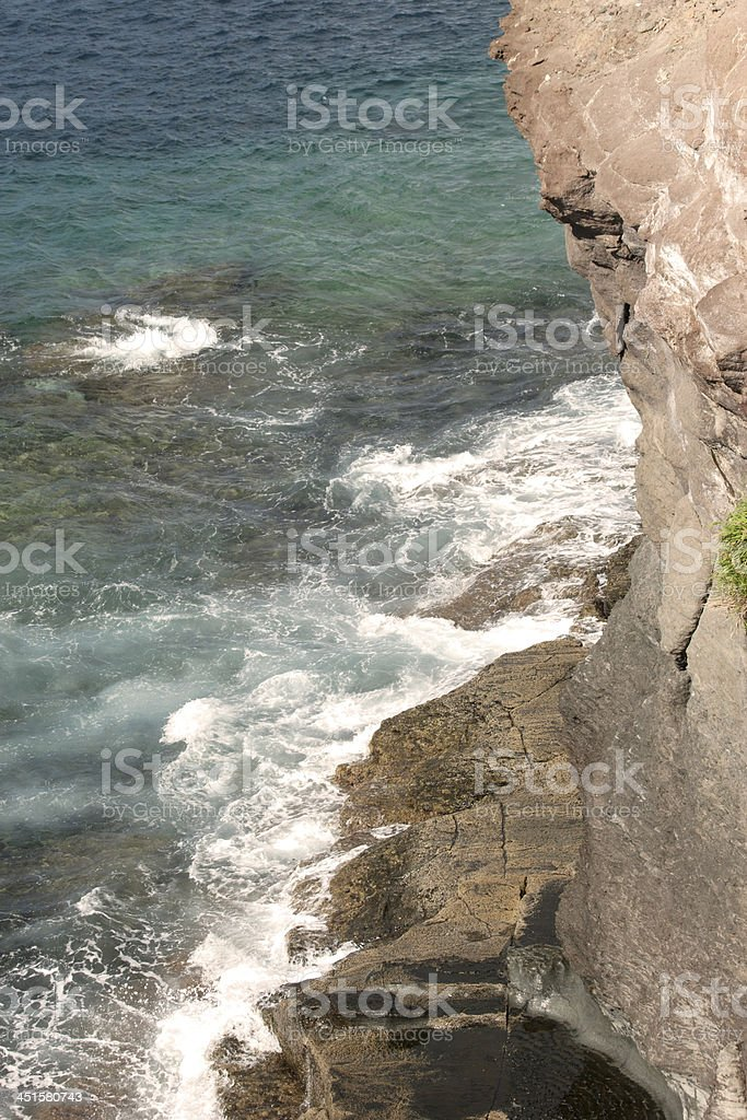 Waves and rock by Atlantic Ocean stock photo