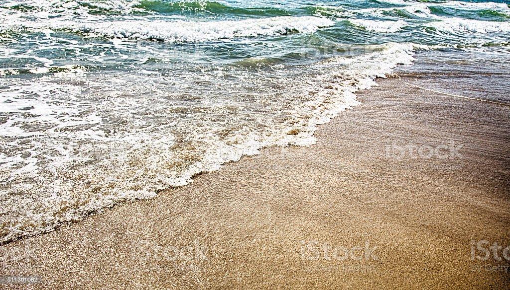Wellen und Sand – Foto