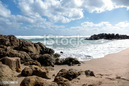 Seascape view with waves and sandy beach in windy day in Deerfield Beach, Florida