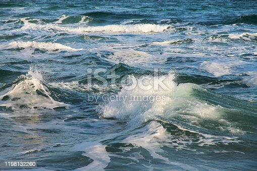 Waves and splashes. The sea is storming. Marine background.