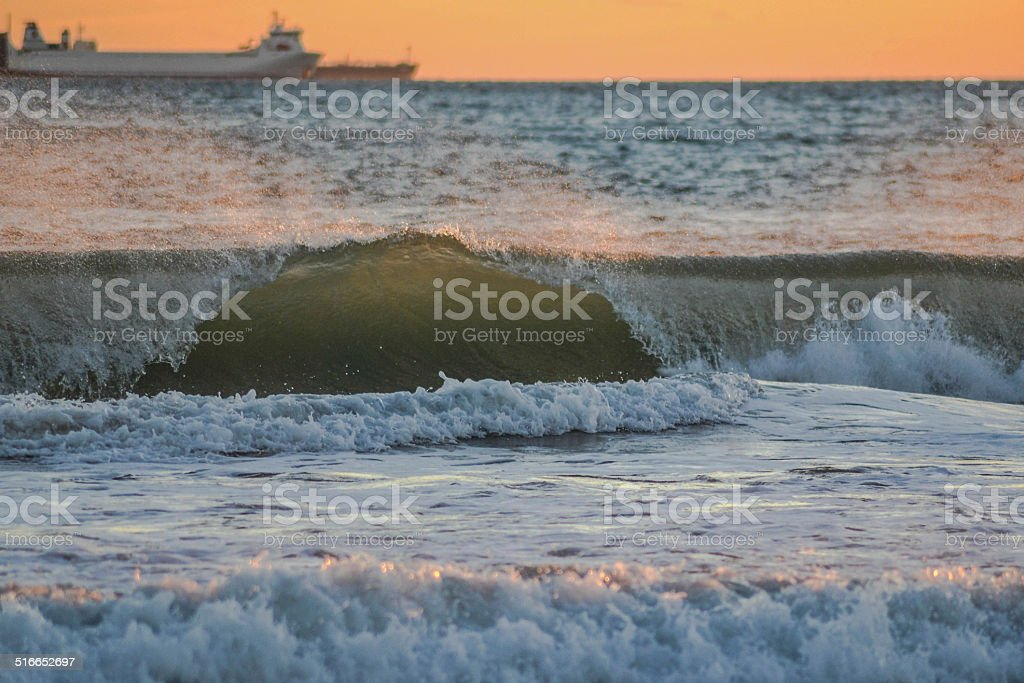 Waves and sunset stock photo