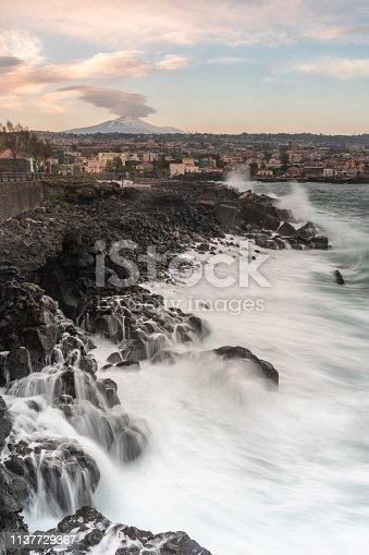 istock waves and wind against the coast 1137729367