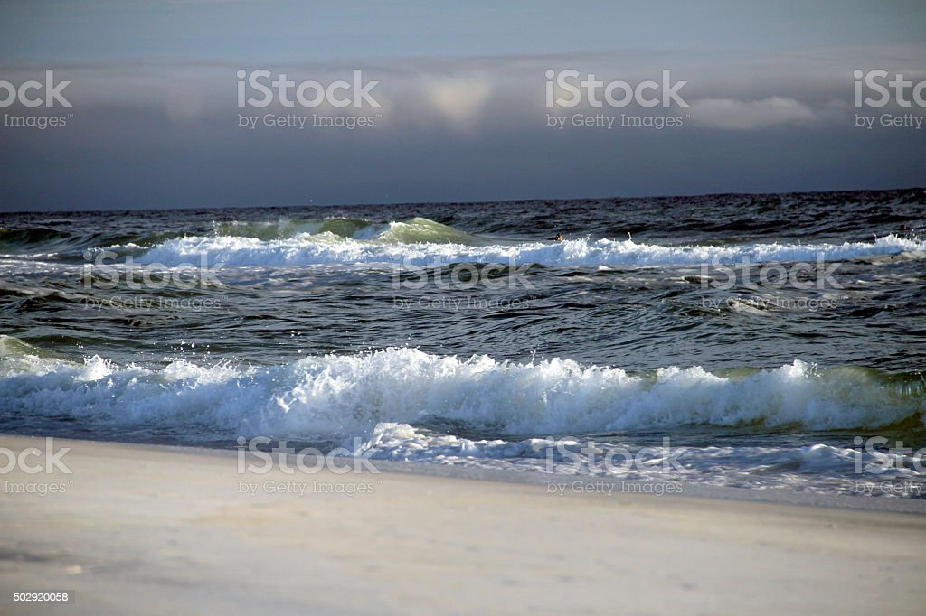 Waves are comming in a windy day in Destin island stock photo
