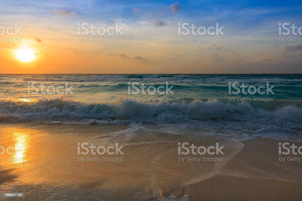 Waves at sunrise stock photo