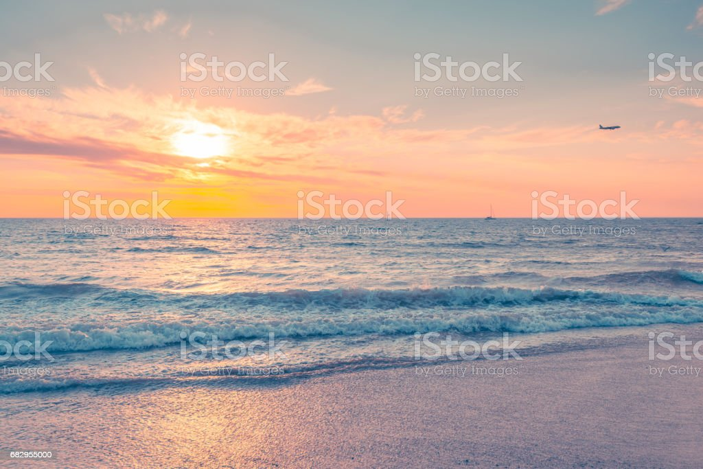 Waves at sunset on a warm evening royalty-free stock photo