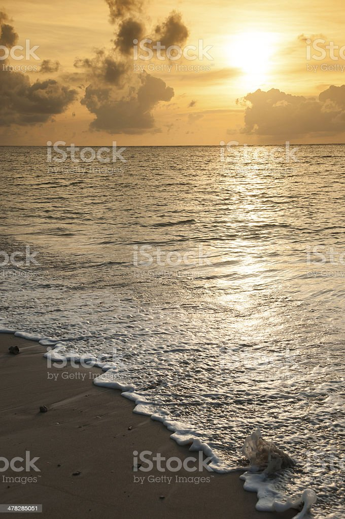 Waves at the beach and sunset. royalty-free stock photo