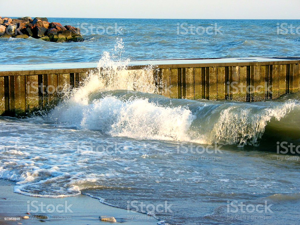 Waves at the pier royalty-free stock photo