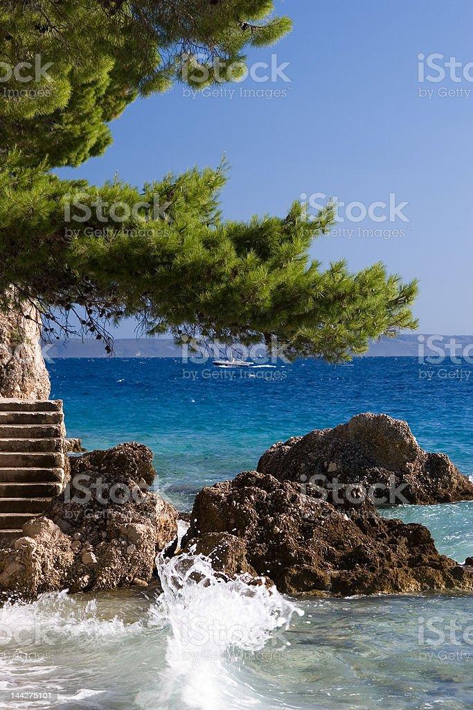 Waves at the rocks in blue sea of Brela Croatia royalty-free stock photo