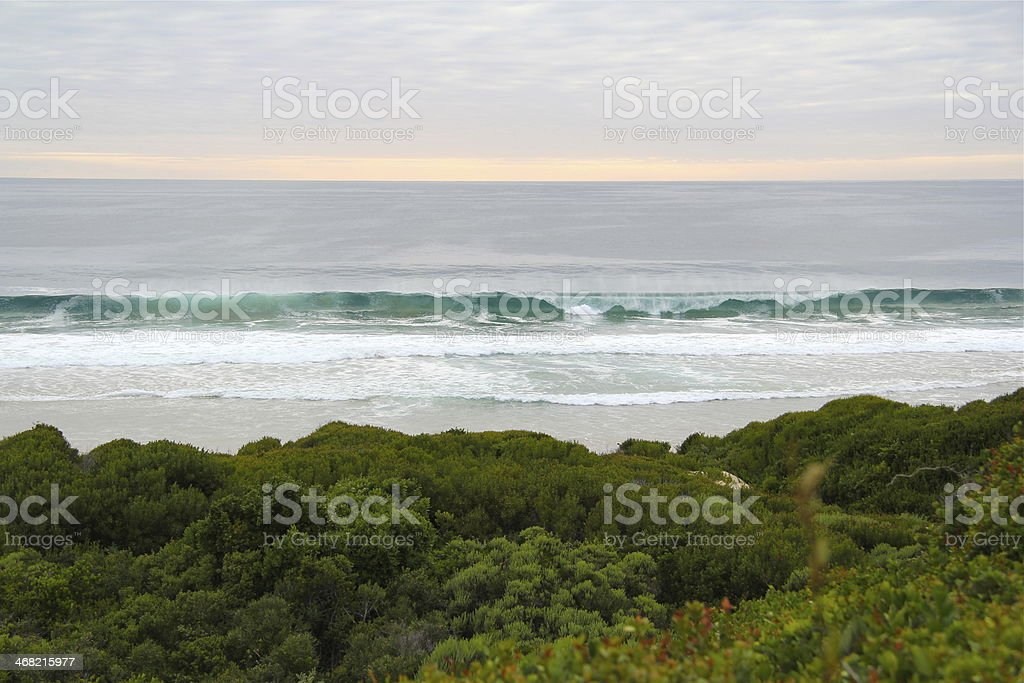 Waves breaking at dawn stock photo