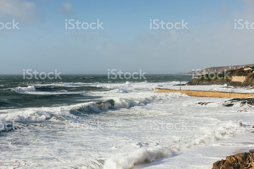 Waves breaking at Porthleven in Cornwall during stormy seas stock photo