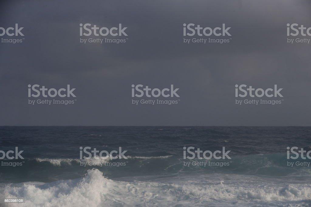 Waves breaking at Shipwrecks Beach in Kauai, Hawaii stock photo