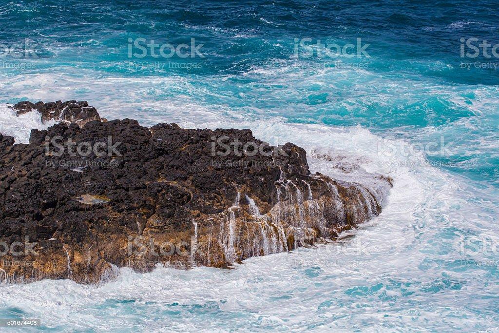 Waves breaking hard on a rock at Philip Island, Australia stock photo