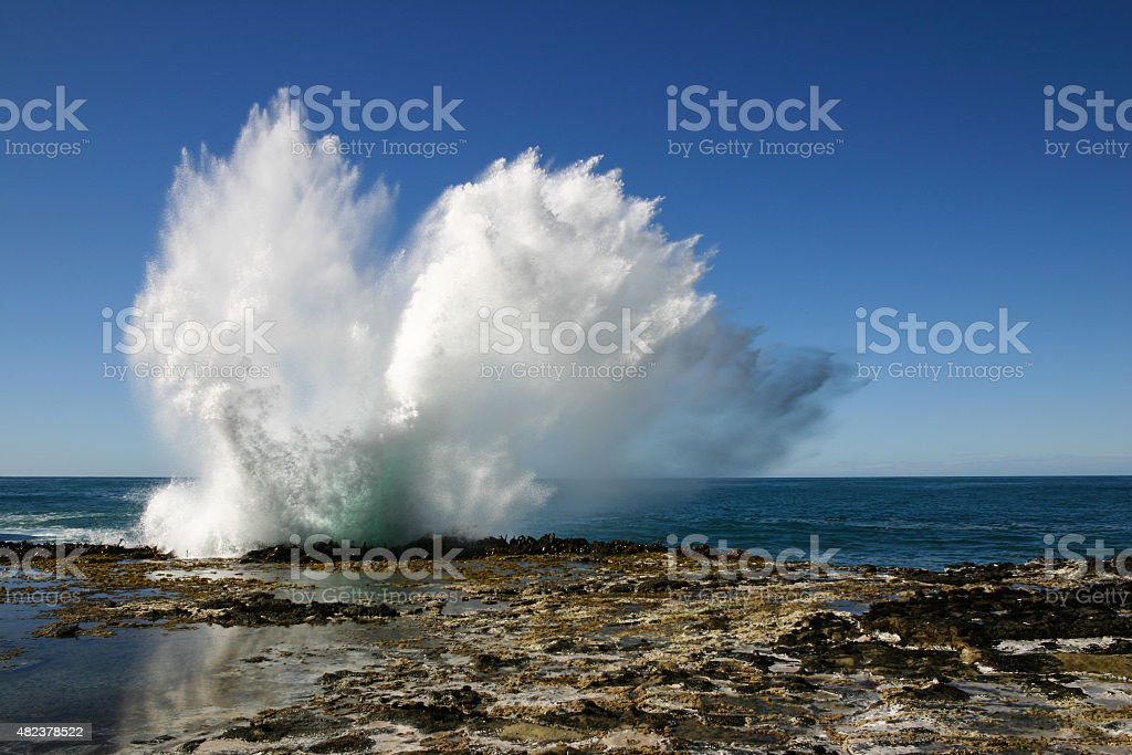 Waves breaking on a rock on the coast stock photo