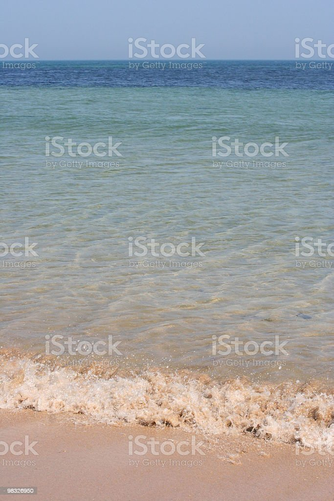 Waves breaking on beach royalty-free stock photo