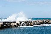 istock Waves breaking on the breakwater 541278468