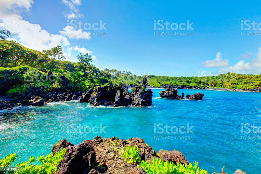 Waves breaking on the rocks on a sunny day. Maui stock photo