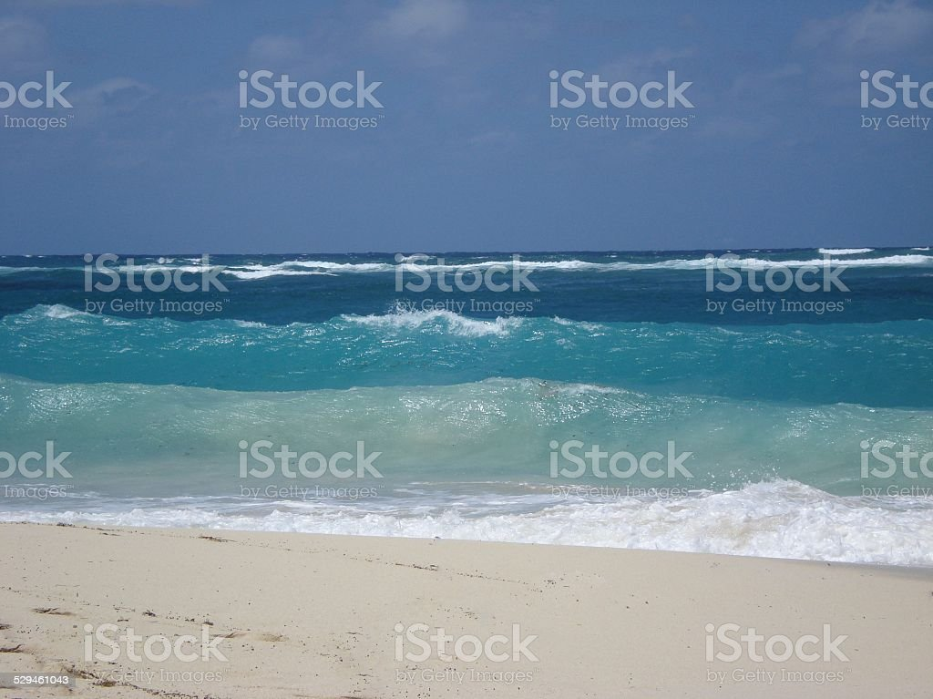 Waves Breaking on White Sand Beach stock photo