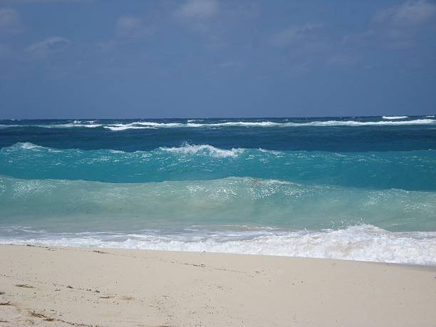 Waves Breaking on White Sand Beach stock photo