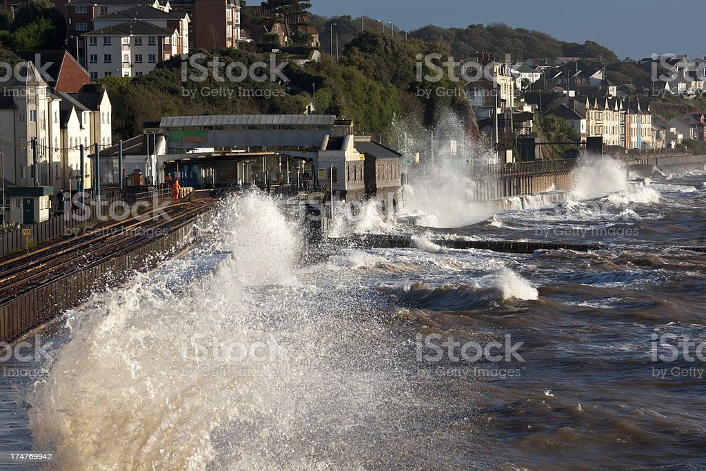 Waves breaking onto sea wall and railway track, Dawlish DEvon royalty-free stock photo