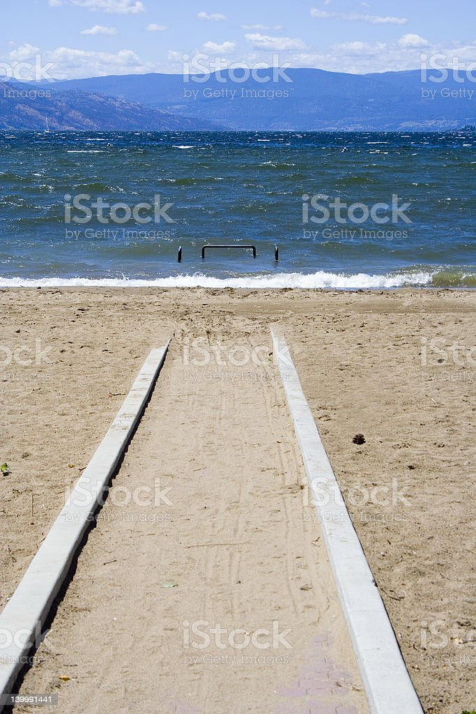 Waves coming in on a beach - wheelchair ramp royalty-free stock photo