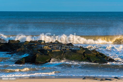 Waves crashing into a  Jetty on a Spring Lake beach