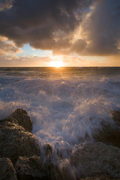 Waves Crashing Against Rocks stock photo