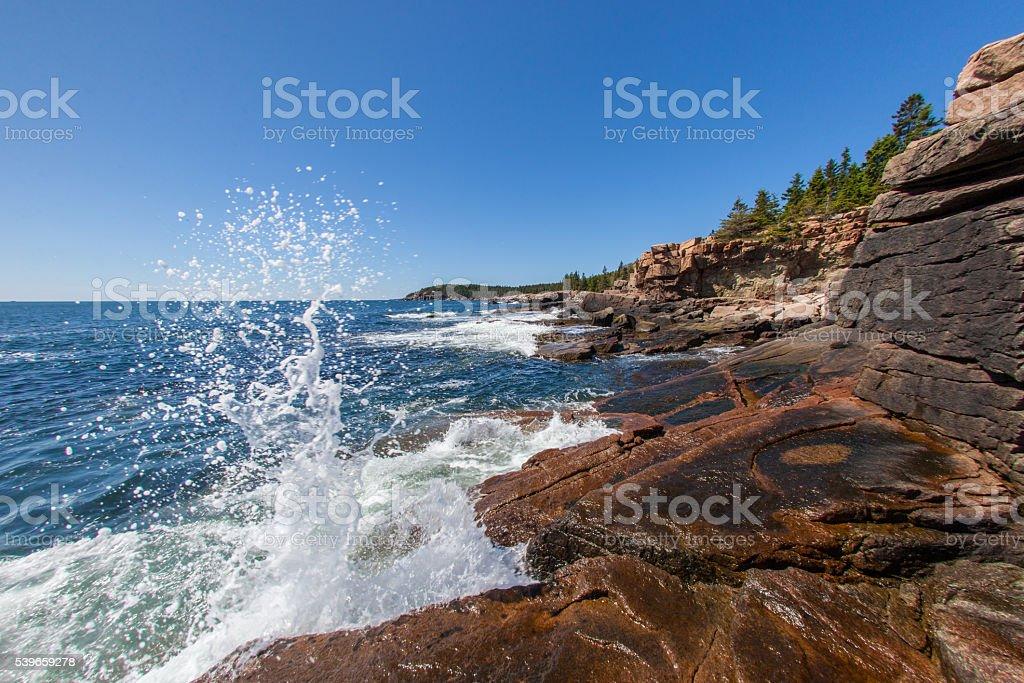 Waves crashing along the coast of Acadia National Park stock photo