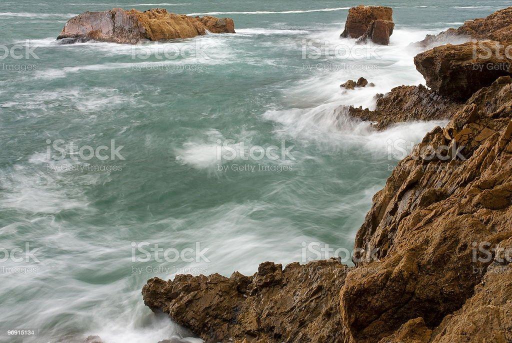 Waves crashing into rocks royalty-free stock photo
