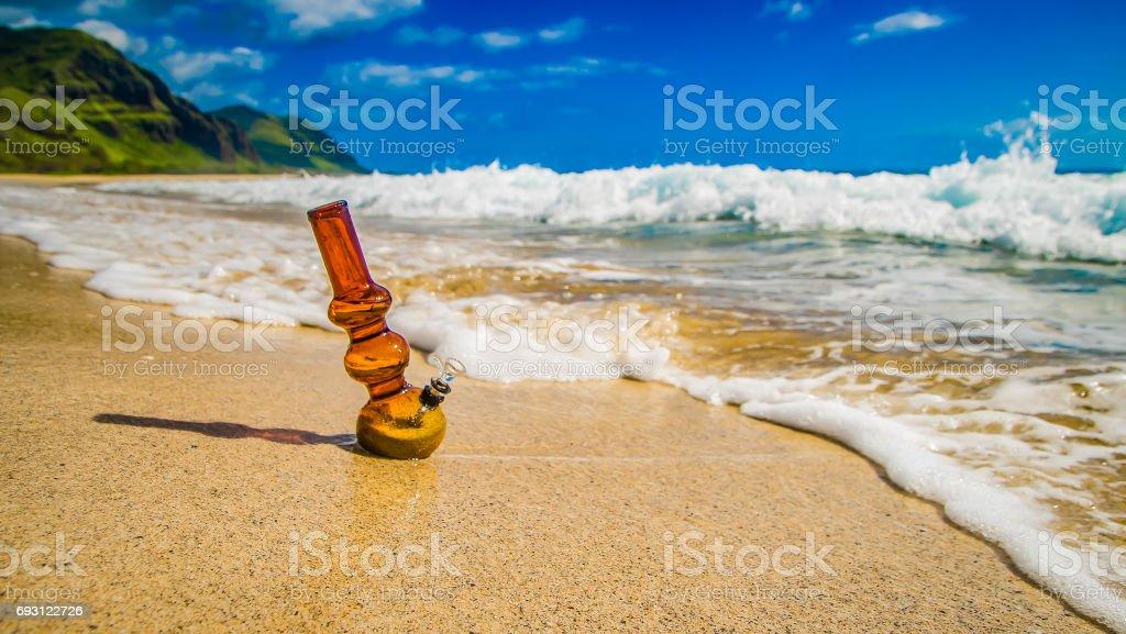 waves crashing near bong on sand stock photo
