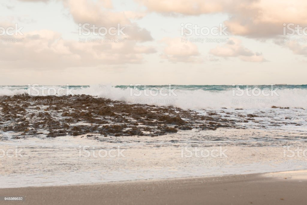 Waves Crashing On A Rocky Beach Stock Photo & More Pictures of