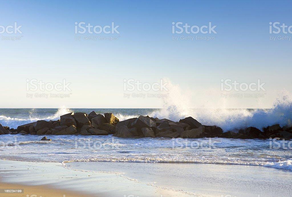 waves crashing on rocks royalty-free stock photo